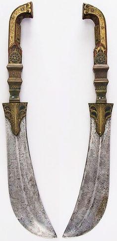Indian (Kodagu) moplah,18th to 19th century, steel, brass, wood (walnut), paste, H. 21 in. (53.5 cm); H. of blade 12 1/2 in. (31.8 cm); W. 2 7/8 in. (7.3 cm); Wt. 1 lb. 9.6 oz. (725.7 g), Met Museum, Bequest of George C. Stone, 1935.
