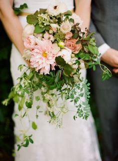 Lush, loose bouquet with soft pink dahlias, dusty pink roses, Blushing Bride proteas, and an assortment of foliage