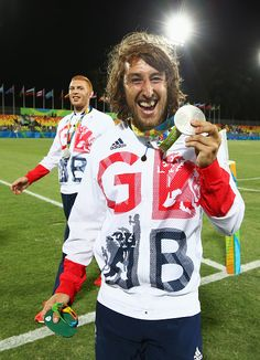 #RIO2016 Dan Bibby of Great Britain celebrates with his silver medal during the medal ceremony for the Men's Rugby Sevens on Day 6 of the Rio 2016 Olympics at...
