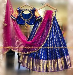 For beautiful and customized designer wear! Wedding Saree Blouse Designs, Half Saree Designs, Pattu Saree Blouse Designs, Saree Blouse Patterns, Lehenga Designs, Half Saree Lehenga, Lehnga Dress, Bridal Lehenga Choli, Bollywood Lehenga