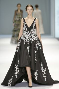 Like so many couturiers this season,Ralph & Russo decided to say it with flowers. [Photo by Giovanni Giannoni]