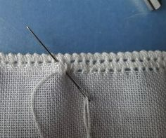 Start with a blank piece of linen (thread hem).
