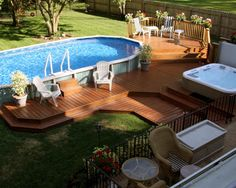 Small oval above ground pool deck ideas with wooden fence and lounge