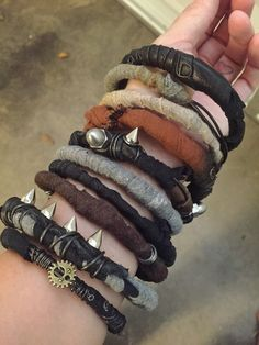 Post-apocalyptic style stackable bangles with gold spikes.. DIY the look yourself: http://mjtrends.com/pins.php?name=tree-spikes-for-jewellery