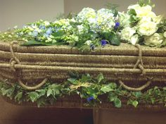 Seagrass coffin with natural garden flowers. Posies, spray and garland… Rustic Flower Arrangements, Funeral Floral Arrangements, Rustic Flowers, Casket Flowers, Funeral Flowers, Green Funeral, Funeral Caskets, Funeral Sprays, Casket Sprays