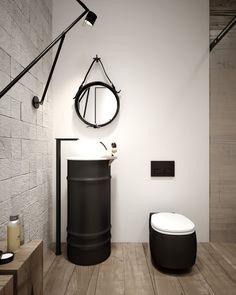 salle de bains de style industriel avec une vasque sur pied et cuvette en noir mat et blanc, revêtement de sol en bois et carrelage mural aspect pierre