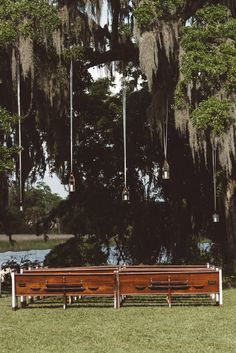 Vintage Church Pews with Hanging Lanterns | Vintage Southern Wedding at Magnolia Plantation Carriage House by Charleston Wedding Planner ELM Events