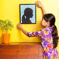 Simple Silhouette: Capture your child's sweet face in this modern take on a classic portrait style