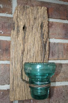 Rustic and just perfect for the back yard. This would be a great idea to reuse all those old glass electric caps!! :)