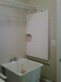 Turn Utility Sink Into Folding Surface/Countertop - traditional - laundry room - other metro - Creative Closets®