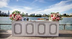 Beautiful flowers adorn the drinks bar with an amazing view of the city, from Carousel, Albert Park Lake. Styling by the Style Co. #foodanddesire #thestyleco www.foodanddesire.com.au