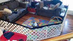 My awesome husband's variation on the DIY Play yard or play pen instructions we found here on Pinterest.  The picture is ours, the link takes you to the website we used as a guideline.