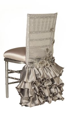 obsessed with this silver and grey ruffled and sparkly chiavari chair cover! wedding chair covers - ruffled skirt and shimmering semi-sheer cover