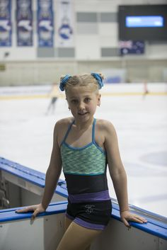 Figure skating training singlet and cute shorts. Shorts have a sparkly snow flake on the bottom. Both comes in a range of colors. For more information head to the web site.  Photo by Michael Santer (OzSkater Mag)  Head to web site to purchase!