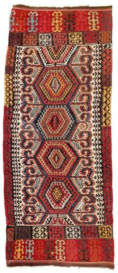 This two-panel kilim by the Hotamis Turkmen was woven in one of the villages of the Konya region - Turkey