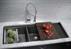 Blanco SILGRANIT Precis Series multilevel double bowl sink with built-in drainboard and a range of included accessories (shown in Anthracite) - available for purchase from PlumbingSupply.com (image courtesy of BLANCOAmerica.com)