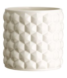 Ceramic plant pot with a geometric pattern. Height 5 in., diameter 4 3/4 in.