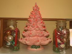 """Vintage Christmas items I picked up at estate sales this year... 2 vintage Apothecary Jars from the late 1800's filled with vintage Christmas bulbs circa 1940s - 1960s. 2 vintage ceramic holly candle holders from the 60's and finally, a 25"""" pink ceramic Christmas Tree from the 70's. My Vintage Christmas!!!"""