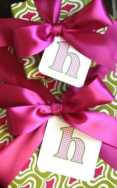 pretty paper, pretty ribbons........Love the initial tags
