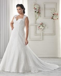 1616 This gorgeous plus size gown comes with a sweetheart neckline and lace cap sleeves that extend to the keyhole back. The fit and flare silhouette is covered with dual lace.