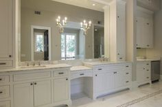 Amazing ensuite with wall of bathroom white bathroom cabinets with drop down vanity, ...