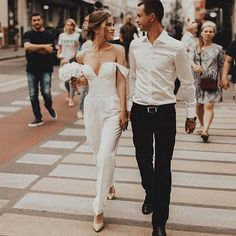 Who says a bride has to wear a dress? This wedding jumpsuit is super chic and modern. If you choose a modern wedding theme, make sure your playlist is up to speed too. wedding outfit Modern Wedding Ideas: The Best Modern Wedding Songs Civil Wedding Dresses, Wedding Gowns, Wedding Outfits, Wedding Rehearsal Outfit, Rehearsal Dinner Dresses, Backless Wedding, Beach Dresses, Bridal Dresses, Dress Beach