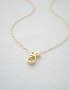 Cursive letter necklace! Order any letter - available in silver, gold or rose gold. $44 and FREE SHIPPING! Message us on Facebook to order! www.facebook.com/twocumberland