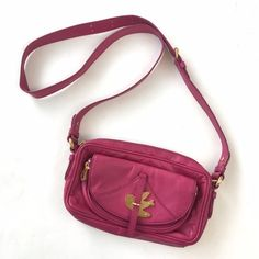 """MBMJ Petal to the Metal Ava Crossbody Bag Genuine leather fuchsia crossbody bag featuring a logo-etched bird on outer flap pocket. Has an adjustable strap, a top zip closure, and an exterior hidden magnetic flap pocket. Lined in the black and white logo print. Light signs of wear; you have to look to notice. Recently cleaned. Approx. 5""""H x 9.5""""L x 3""""D with a 22"""" strap drop. Please carefully review each photo before purchase as they are the best descriptors of the item. My price is firm. No…"""