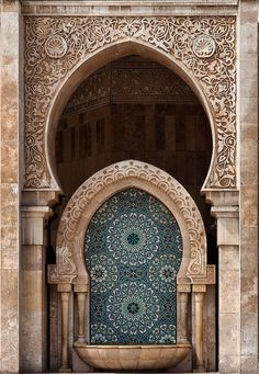 Beautiful relief carving detail in this entryway/wall fountain in Casablanca, Morocco