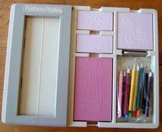 Fashion Plates toy - Best thing ever!!!!  I remember having one of these when I was younger! :)