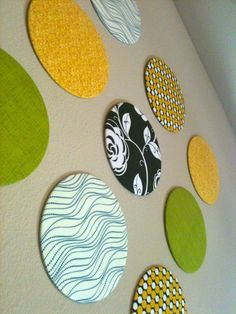 DIY Fabric Circles Wall Decor. Ah! I did something like this a few months ago with cardboard cake stand circles/scrapbook paper/modge podge. LOVE them.