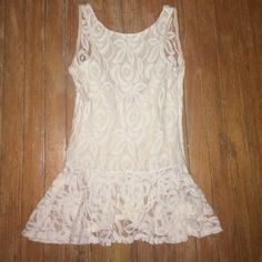 Lace Peplum Top Ivory lace peplum top with low back. The back is sheer and the front has a nude liner.  Shirt had a side zip for perfect fit. Worn once, really beautiful! Vintage Havana Tops Blouses