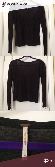 Free People Black long sleeve Offers Welcome! Free People sheer black long sleeve with deep scoop neck. 100% cotton.  Feel free to make an offer or bundle & save. Free People Tops Tees - Long Sleeve