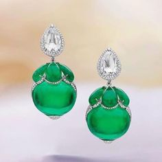 Devine diamond and magnificent emerald earrings by @boghossianjewels. Beautifully cut matching cabochons and epic matching oval cabochon emeralds that weigh over 20ct's each!! Regram from…