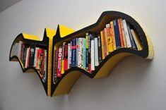 Pin for Later: Make Your Home a Geeky Wonderland With These Finds Na na na na — Batshelf! Squeeze graphic novels and various books about justice into this handmade Batman bookshelf.