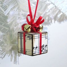 I consider this...the gift of music!  Small Ornament Red Christmas Ornament Sheet Music by rrizzart, $10.00