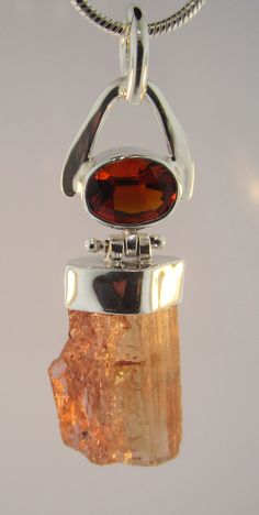 Sterling silver pendant with oval citrine and a raw topaz crystal designed and created by our resident goldsmith, Jeff Foster!