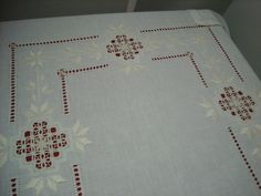 Hemstitch ending in klosters with  pretty design.