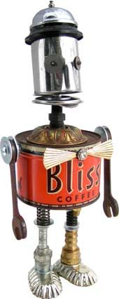 """Name: Nerdvana  D.O.B.: 10/22/11  Height: 17""""  Principal Components: Coffee can, cream pitcher, desk bell, wrenches, clock gears, tartlet tins, hydraulic fittings, lamp part, spring, button.  Amy Flynn Designs."""