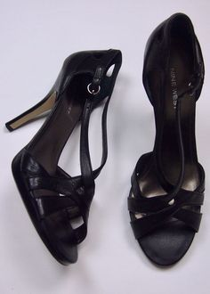 """Fabulous pair stiletto, skinny heeled sandals. Black """"crisscross"""" with ankle closure. Great style to dress up or down, with so many outfits, in every season. I great pair of versatile black heels. 