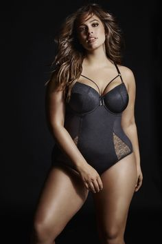 Ashley Graham BODYSUIT WITH GEOMETRIC LACE. Sexy from every angle, this bodysuit with plunging neckline and strapping detail exudes seductive allure.