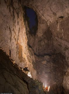 Cave in Vietnam: Mr Deboodt said: 'It shows how powerful nature can be, carving out this huge cave in rock, and how tiny we humans really are in th...