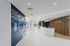 Microsoft's Moscow Technology Center Offices / UNK Project Architects -- Two notes: Hard to believe that the display panel to the left didn't have its bezel shrouded, and that ceiling is an acoustical tile, Rigitone, which makes it look like a seamless product.