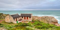 De Hoop Nature Reserve is one of the largest natural areas managed by CapeNature. This reserve is a favourite for hikers, cyclists, bird and whale watchers. Nature Reserve, Modern Buildings, Places To Travel, South Africa, Cabin, Cottages, Whale, Hoop, Architecture