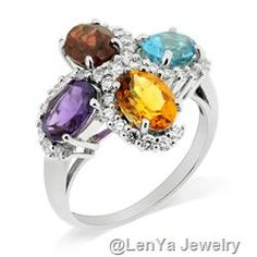 sterling silver ring with garnet, blue topaz, citrine and amethyst.