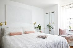 This dreamy all-white bedroom makeover is pure perfection! A stunning all white bedroom featuring clear acrylic side table with brass sconce and green plant. Best White Paint, White Paint Colors, Bedroom Paint Colors, Acrylic Side Table, All White Bedroom, Large Beds, Brass Sconce, Stylish Bedroom, Mirrored Furniture