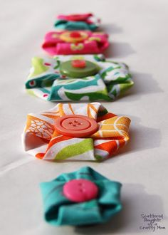 ButtonArtMuseum - Simple and so cute! No-Sew Fabric Flowers. Colorful and joyful. I will adapt these for therapy...not sure how, but I will!