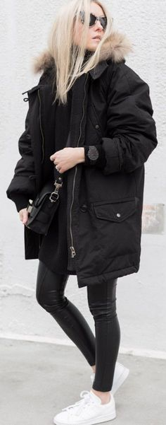 Figtny is wearing a Black Marant Parka, a black Hope Marine sweater, White Stan Smith sneakers and leggings from Aritzia Wilfred Rebelle....   Style Inspiration
