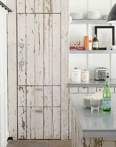 THIS fridge blends perfectly with the rest of the reclaimed wood cabinets!