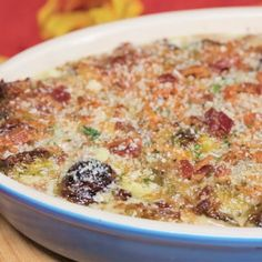 Recipe with video instructions: This creamy, bacon-y casserole will be your new favorite comfort food. Ingredients: 1/2 pounds bacon, diced into 1/4-inch pieces, 2 pounds Brussels sprouts, cleaned and cut in half, Salt and pepper, 1 tablespoon garlic, minced, 1 shallot, peeled and minced, 4 tablespoons butter, 2 tablespoons flour, 2 cups heavy cream, 1 1/2 cups white cheddar cheese, 1/2 cup panko breadcrumbs, 1/4 cup Parmesan cheese, Pinch of cayenne